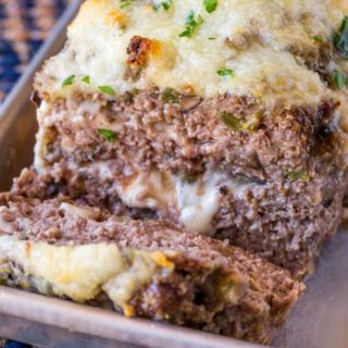 Philly Cheesesteak Meatloaf with green bell bell peppers, onions and mushrooms topped and stuffed with Provolone Cheese.