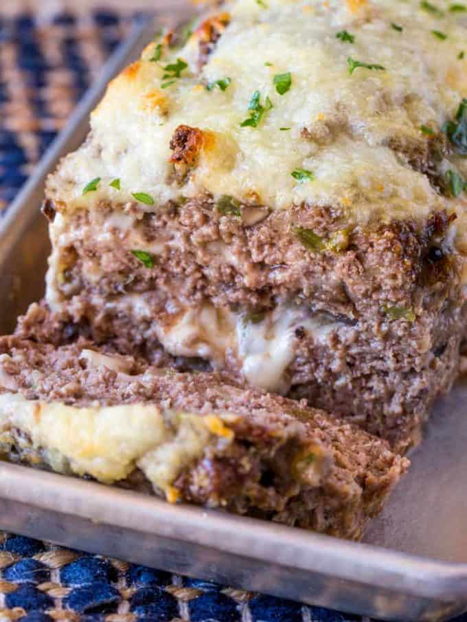 Philly Cheesesteak Meatloaf with green bell peppers, onions and mushrooms topped and stuffed with Provolone Cheese.