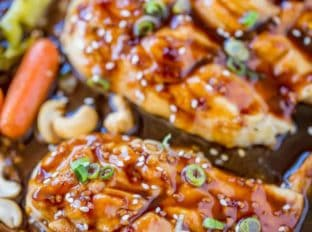 Sheet Pan Cashew Chicken and Vegetables is spicy, sweet and full of your favorite takeout flavors with garlic, hoisin sauce and sriracha without the frying.