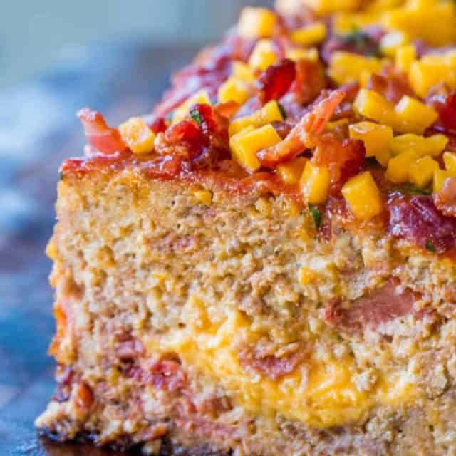 Bacon Cheeseburger Meatloaf topped and stuffed with cheddar cheese and bacon is the ultimate meatloaf. Makes amazing sandwiches too.