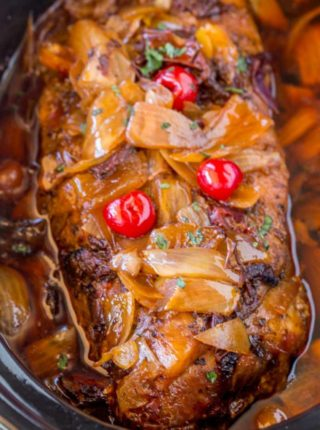 Slow Cooker Dr. Pepper Pulled Pork is sweet and spicy with brown sugar, maraschino cherries and candied jalapenos. Perfect for dinners or lunches in sandwiches and so easy to make!