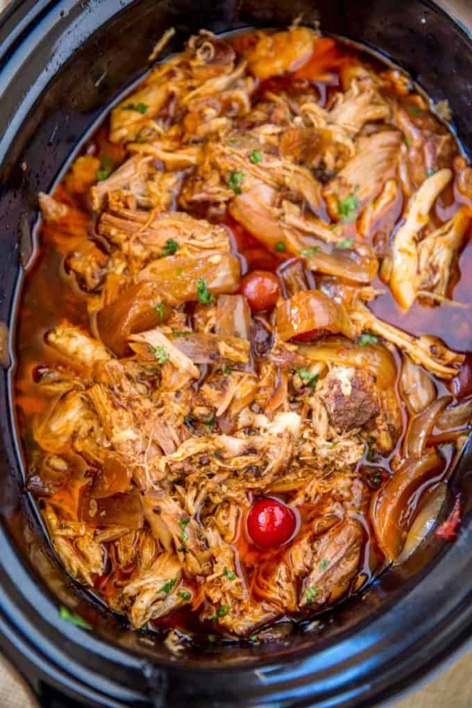 Slow Cooker Dr. Pepper Pulled Pork is sweet and spicy with brown sugar, and sweet with cherries and brown sugar.