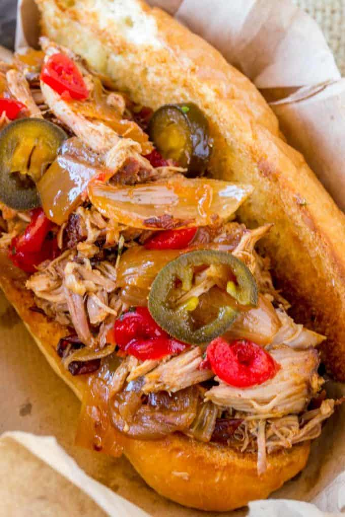 Slow Cooker Dr. Pepper Pulled Pork is perfect served many different ways including in these sub sandwiches.
