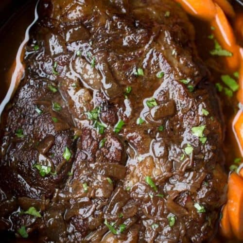 Slow Cooker Balsamic Pot Roast with a rich balsamic glaze and tender fall apart beef, you'll LOVE this whole meat in one pot!