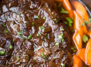 Crockpot Balsamic Pot Roast with a rich balsamic gravy and carrots and potatoes.