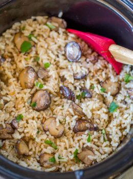 Slow Cooker Mushroom Rice made with mushrooms, caramelized onions and thyme is a deliciously buttery easy addition to your holiday meals! Stovetop directions too.
