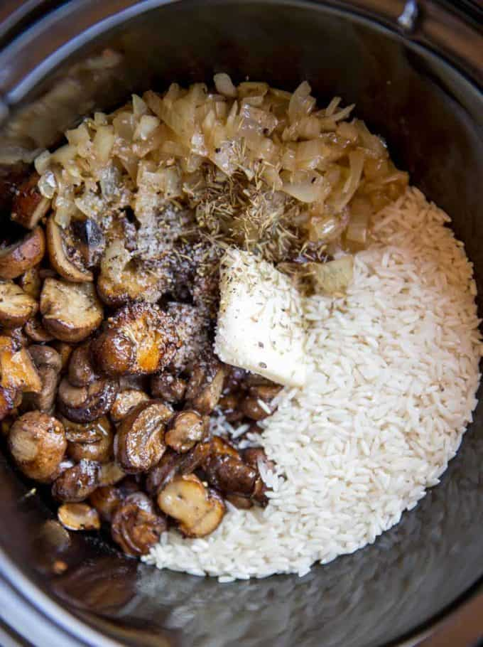 Slow Cooker Mushroom Rice with mushrooms, caramelized onions and thyme is a deliciously buttery addition to your holiday meals! Stovetop directions too.