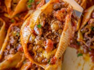 Cheesy Taco Stuffed Shells made with jumbo pasta shells, salsa, cheese and taco meat are the perfect EASY weeknight meal that you can prepare ahead of time too!