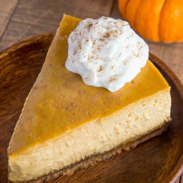 The perfect holiday dessert, this is the ULTIMATE Pumpkin Cheescake with a gingersnap crust.