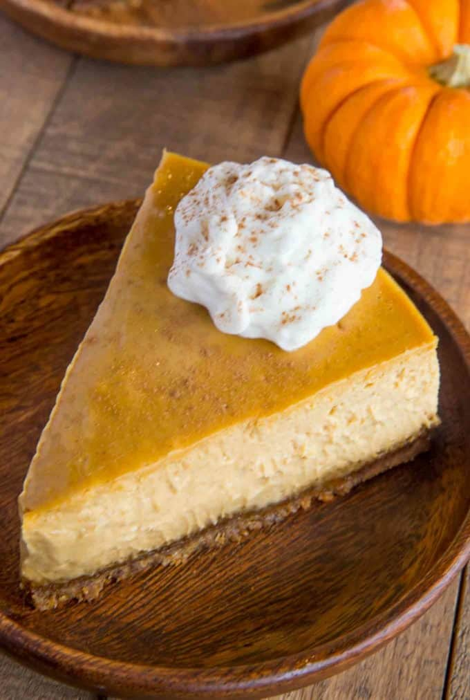 The perfect holiday dessert, this is the ULTIMATE Pumpkin Cheesecake with a gingersnap crust.