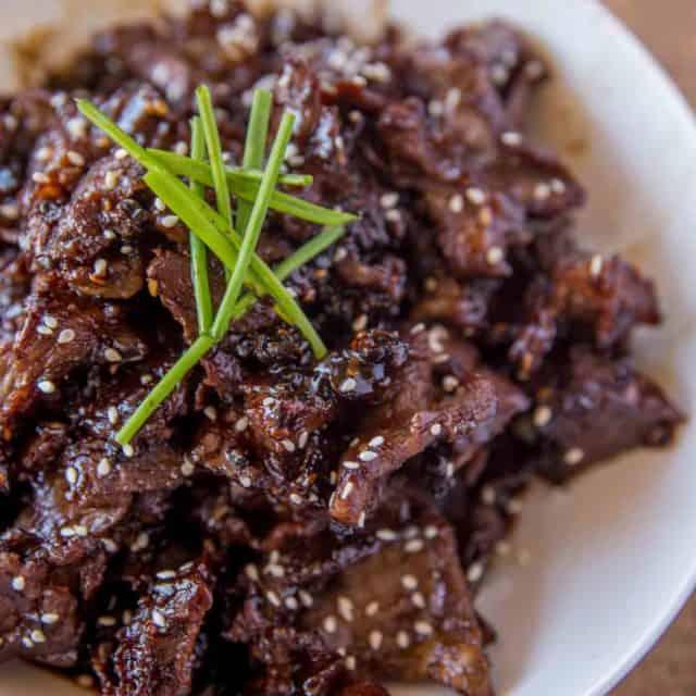 Crispy Orange Beef made with crispy, tender slices of steak coated in an orange garlic-ginger sauce in just 30 minutes!
