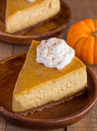 Creamy, rich and decadent Pumpkin Cheesecake with Gingersnap Crust.