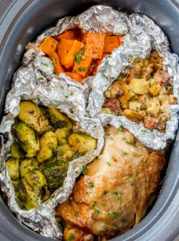 Slow Cooker Thanksgiving Dinner with turkey, sweet potatoes, sausage stuffing and Brussels Sprouts cooked entirely in your Slow Cooker!