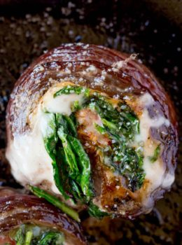 Spinach Artichoke Stuffed Flank Steak is a show stopping dish with provolone, spinach and artichokes that is dinner party ready in half an hour.