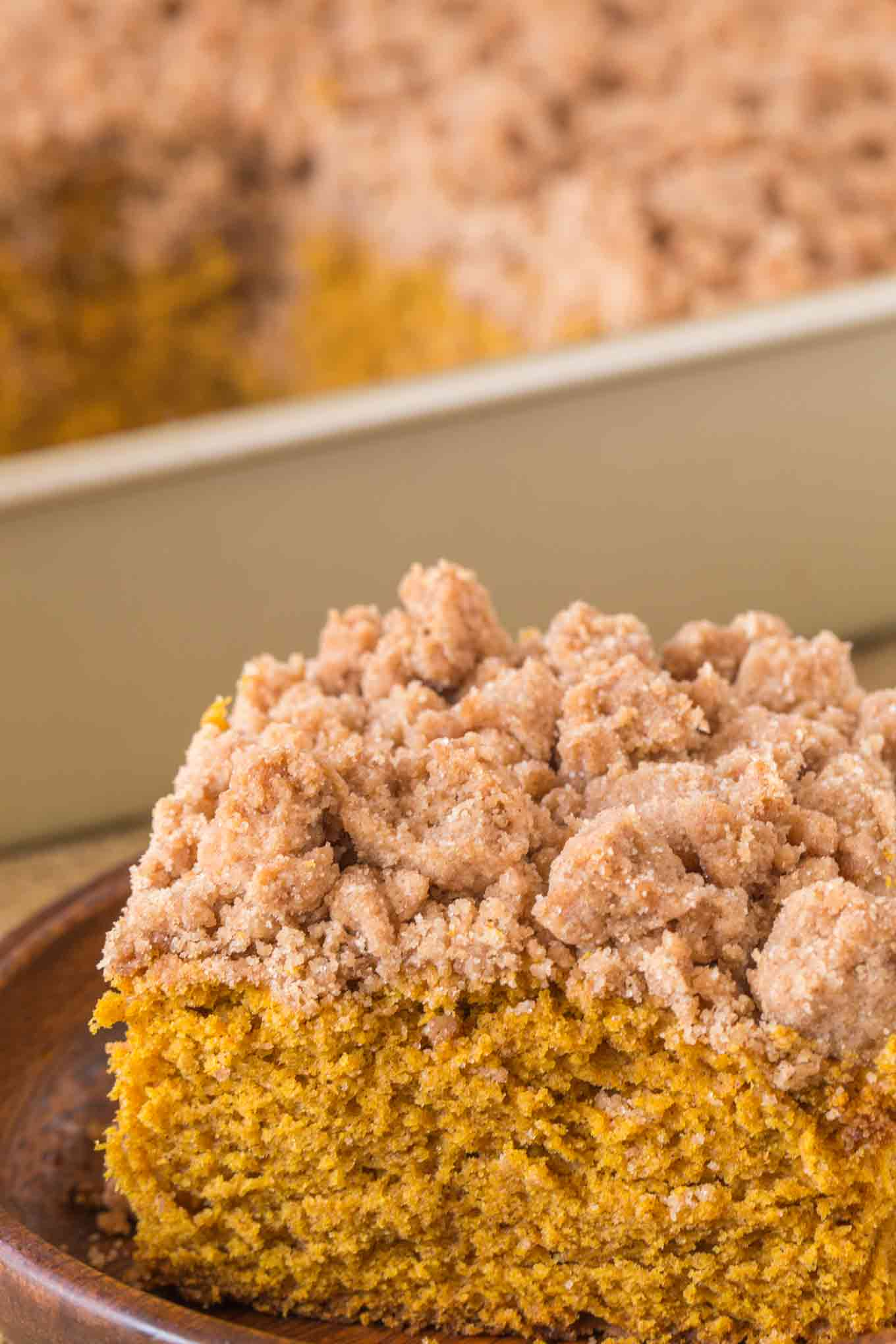 Pumpkin Crumb Cake with a New York Bakery Style giant brown sugar crumble topping is a fall bakery treat you'll enjoy for breakfasts all winter long.