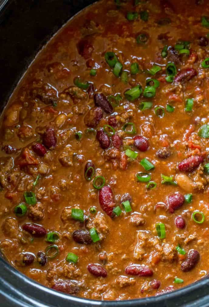 crockpot chili with scallions on top