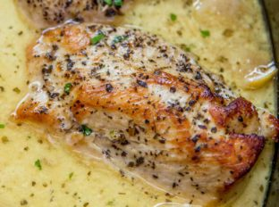 Slow Cooker Creamy Lemon Chicken with butter, garlic and lemon coating tender chicken breasts in a creamy sauce. Even great as a pasta topping!
