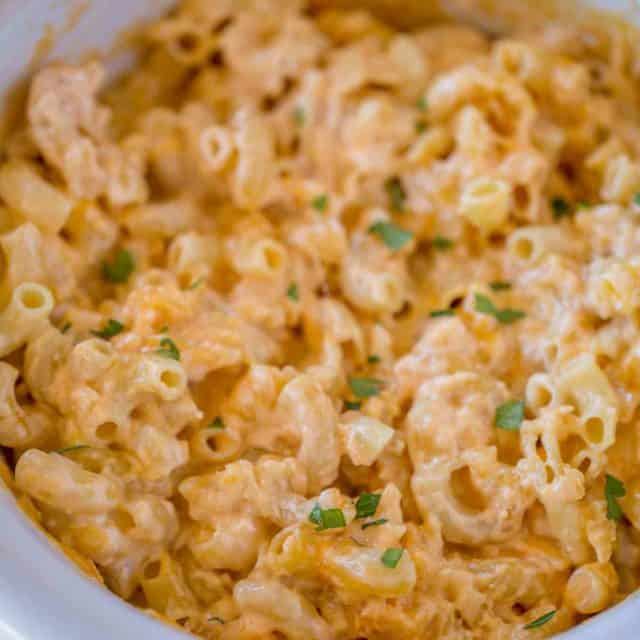 Slow Cooker Mac and Cheese is super creamy and cheesy with no boiling or pre-made noodles and no velveeta or condensed soups!