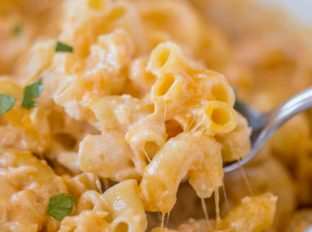 The easiest creamiest and cheesiest Slow Cooker Macaroni and Cheese!