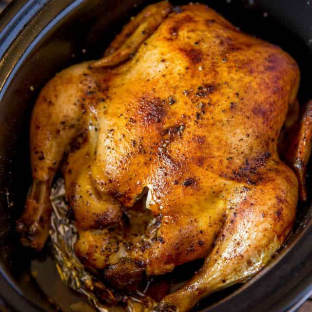 Slow Cooker Rotisserie Chicken made with just a few spices and in the slow cooker with CRISPY skin without a second spent in the oven!