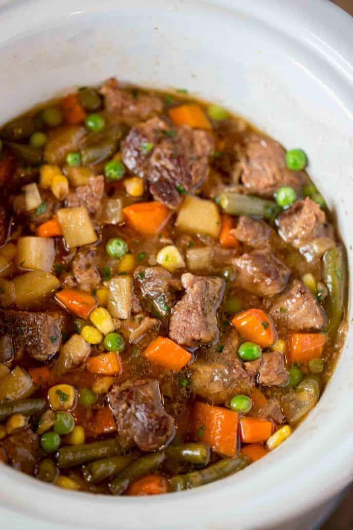 The BEST Slow Cooker Beef and Vegetable Soup you'll ever eat and so easy to make!