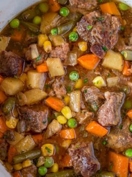Slow Cooker Vegetable Beef Soup with is the most comforting, EASY soup you'll make. You'll want to dip crusty bread into the amazing flavors in this soup!