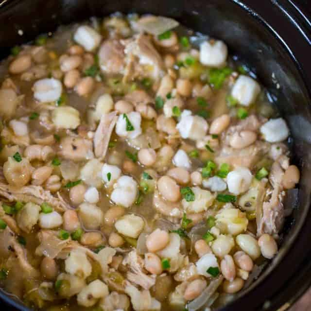 Slow Cooker White Chicken Chili with hominy, white beans, chicken and peppers is the perfect, easy white chicken chili of your dreams.