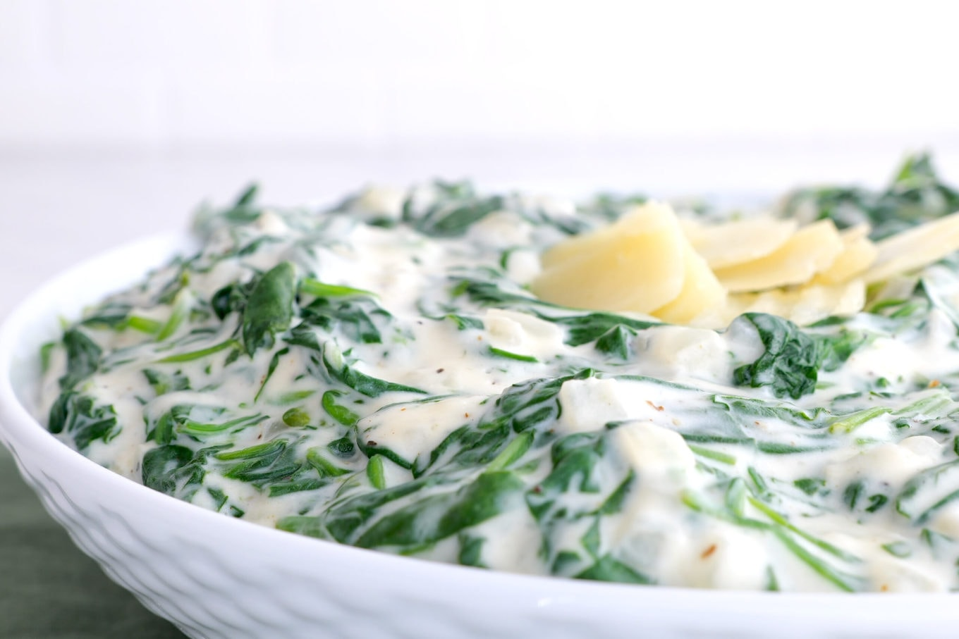 Morton's Steakhouse Creamed Spinach in bowl with parmesan garnish