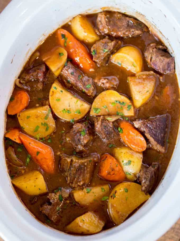 Ultimate Slow Cooker Beef Stew made with chuck roast, Yukon potatoes and carrots for a rich beef stew that is perfect for the cold weather.