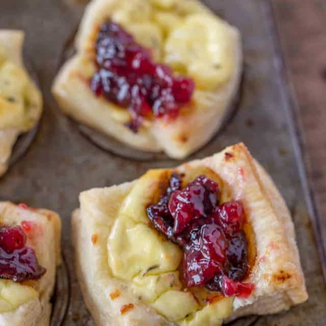 Cranberry Goat Cheese Pastry Bites with just five ingredients are the easiest appetizers you'll ever serve your guests. Perfect for the holidays!