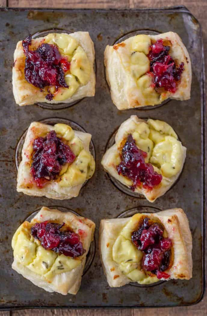 The easiest holiday appetizer you'll ever make. Goat Cheese Pastry Bites with cranberries.