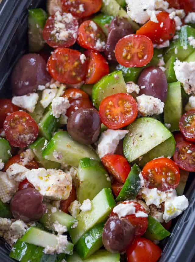 Easy Greek Salad with cucumbers, grape tomatoes, feta cheese and kalamata olives with a lemony red wine vinaigrette dressing in just five minutes.
