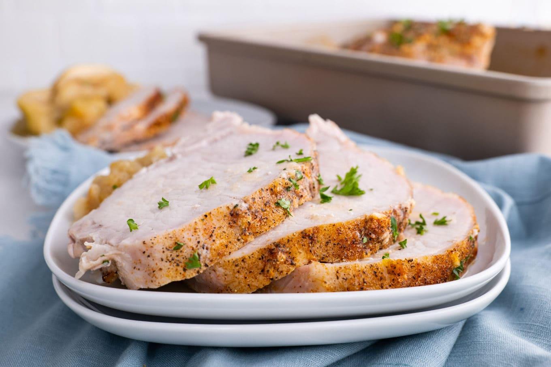 Ultimate Garlic Pork Loin Roast sliced on plate