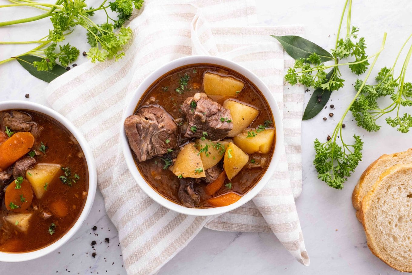 Ultimate Slow Cooker Beef Stew in bowl with parsley garnish