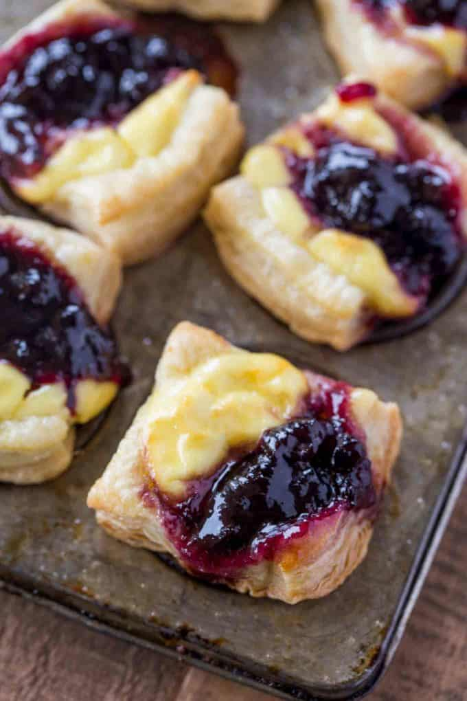 Blueberry Vanilla Goat Cheese Pastry Bites with just five ingredients are the easiest appetizers you'll serve your guests. Prep ahead of time for parties.