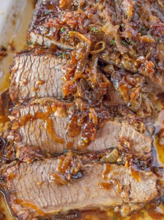 This brisket is perfect and topped with buttery caramelized onions.