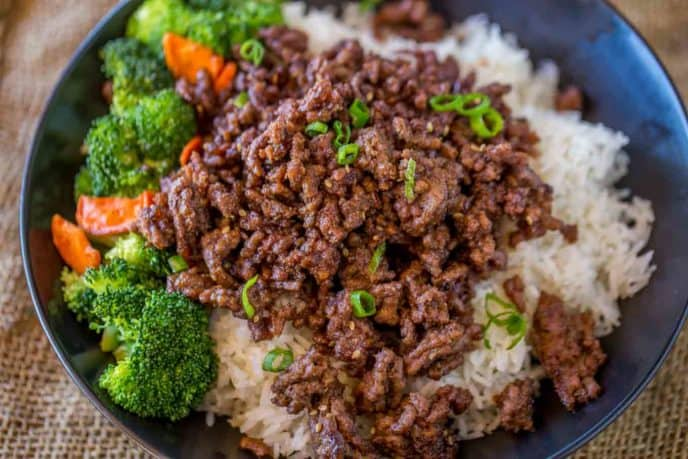 Ground Mongolian Beef in bowl with broccoli, carrots and rice.