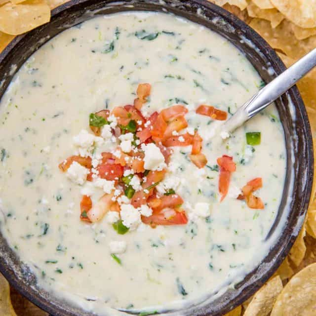 White Spinach Queso in pan with chips