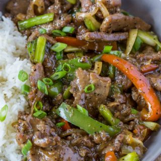 Chinese Pepper Steak in bowl with rice