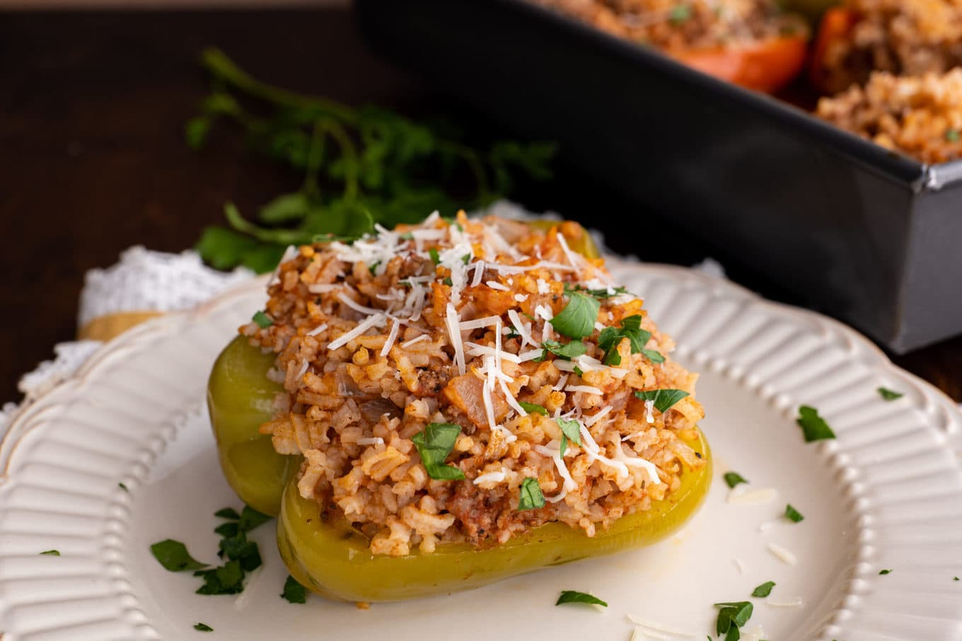 Stuffed Peppers on plate with parmesan & parsley