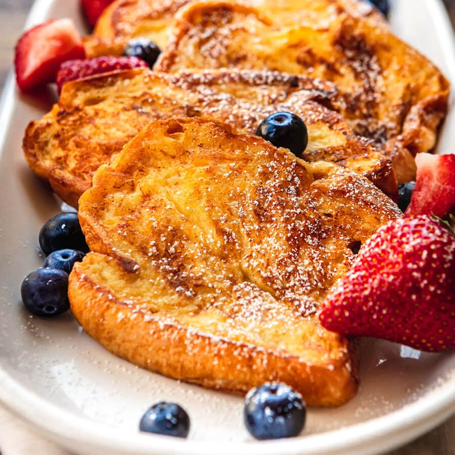 French Toast on plate with strawberries and blueberries