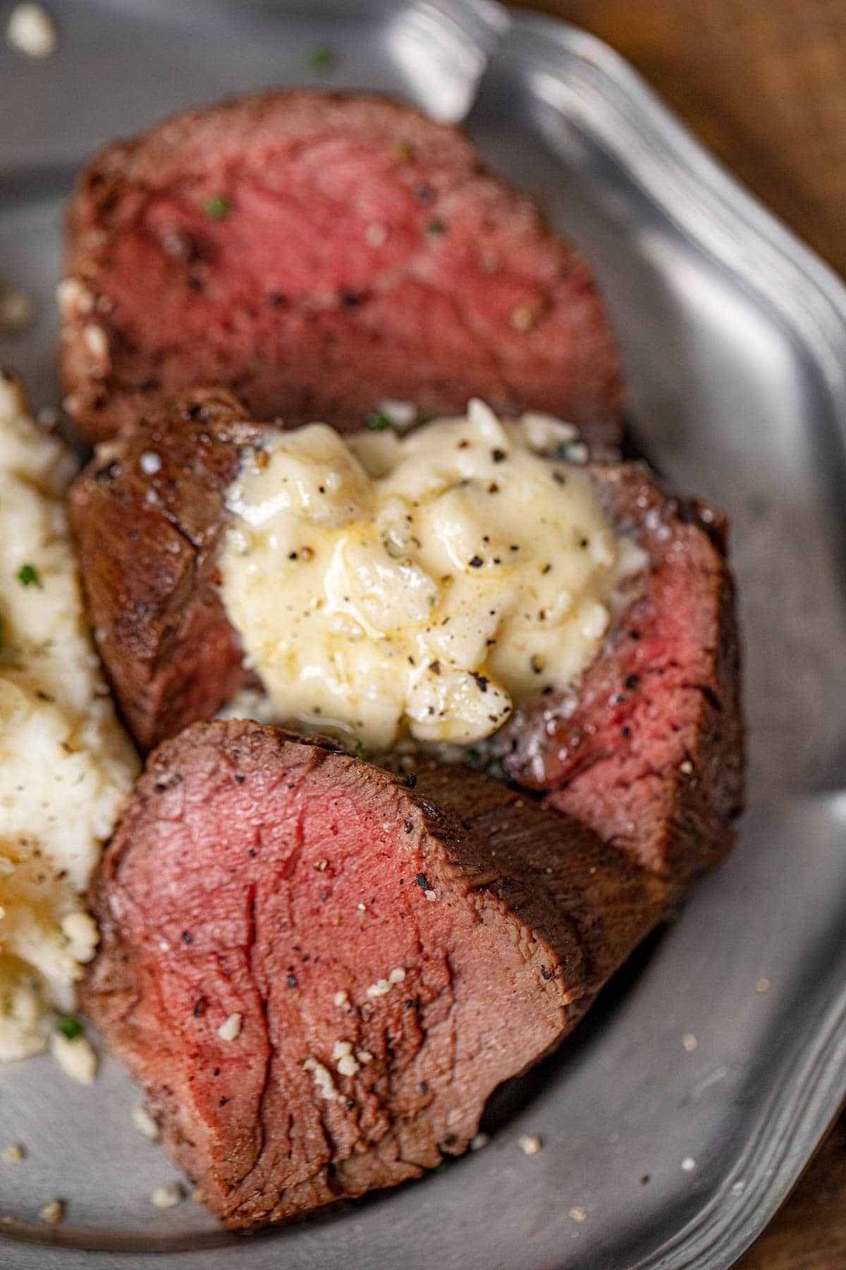 Beef Tenderloin on plate with Blue Cheese Butter