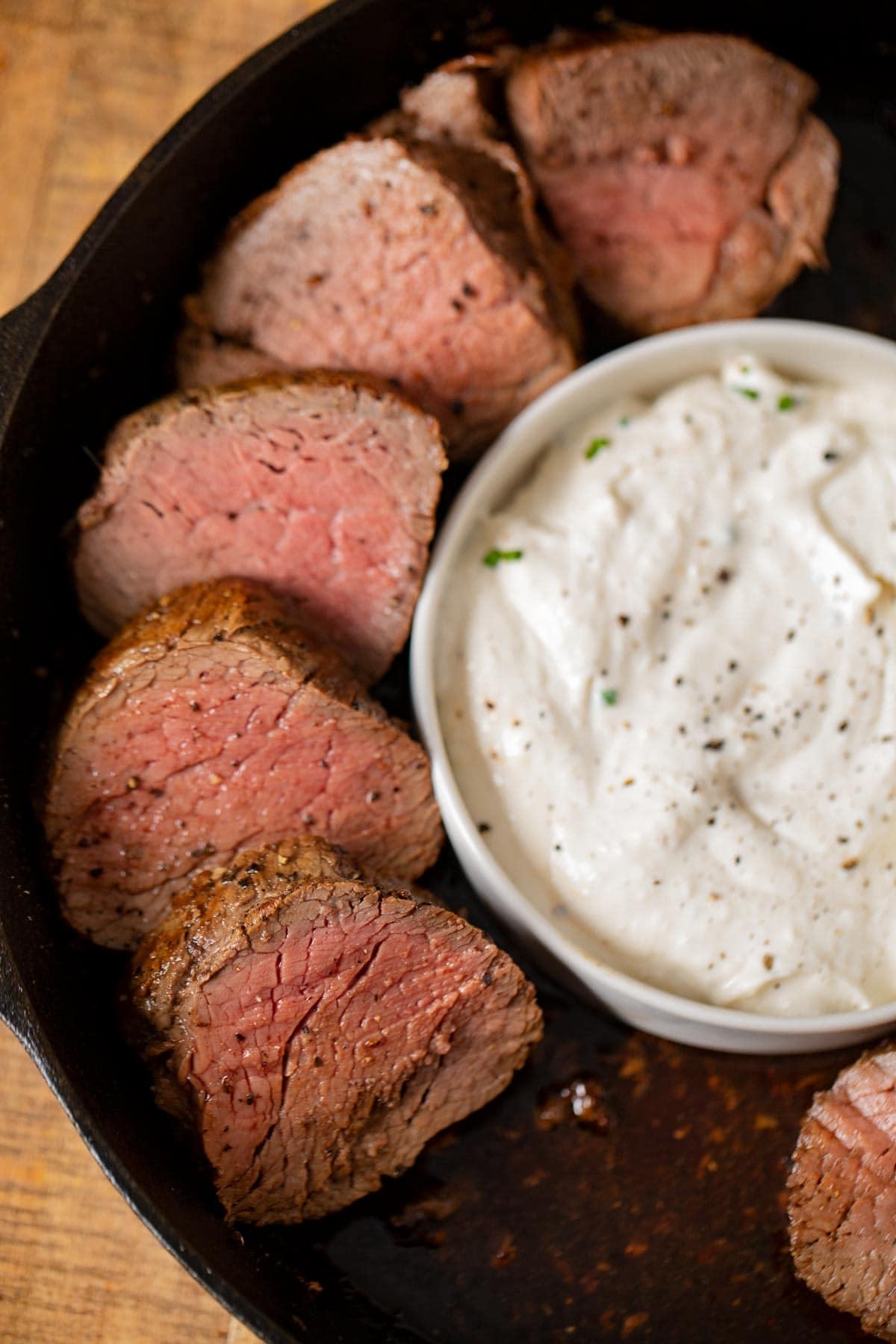 Beef tenderloin steaks in a cast iron pan