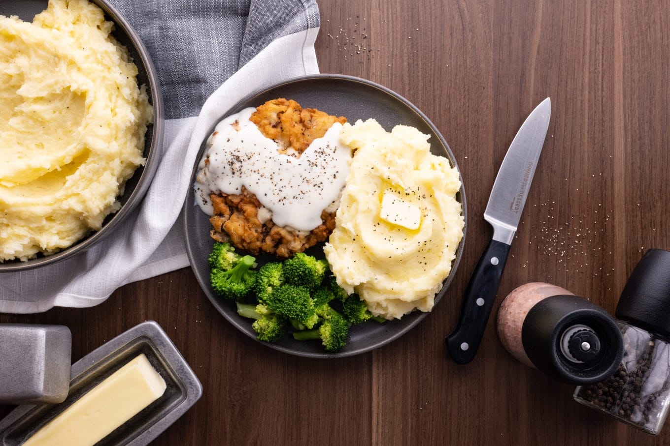 Easy Mashed Potatoes on plate with broccoli and chicken fried steak with gravy