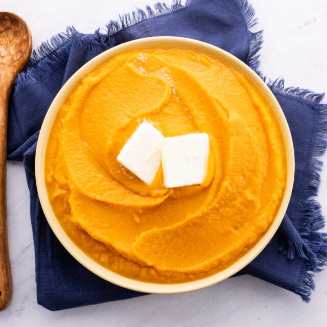 Mashed Sweet Potatoes in bowl with butter