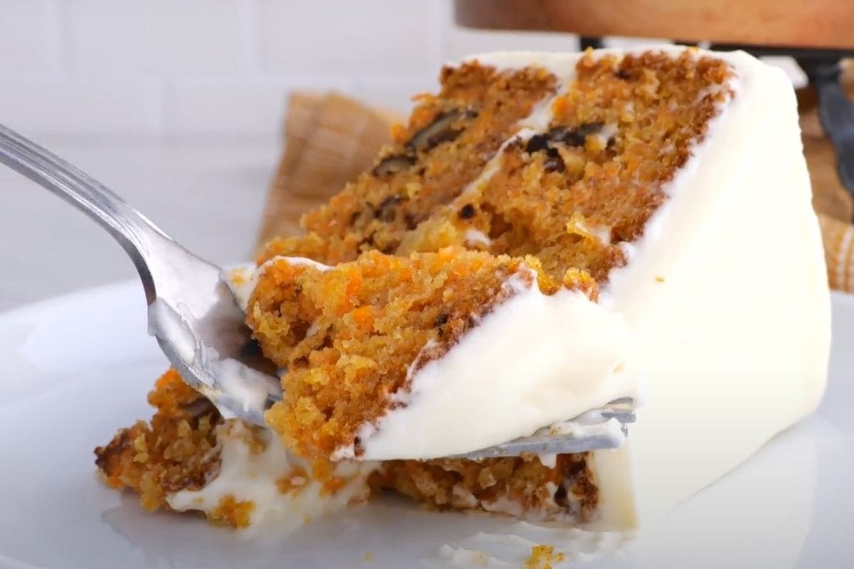 Classic Carrot Cake slice on plate with fork
