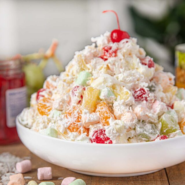 Ambrosia Salad in bowl on brown table
