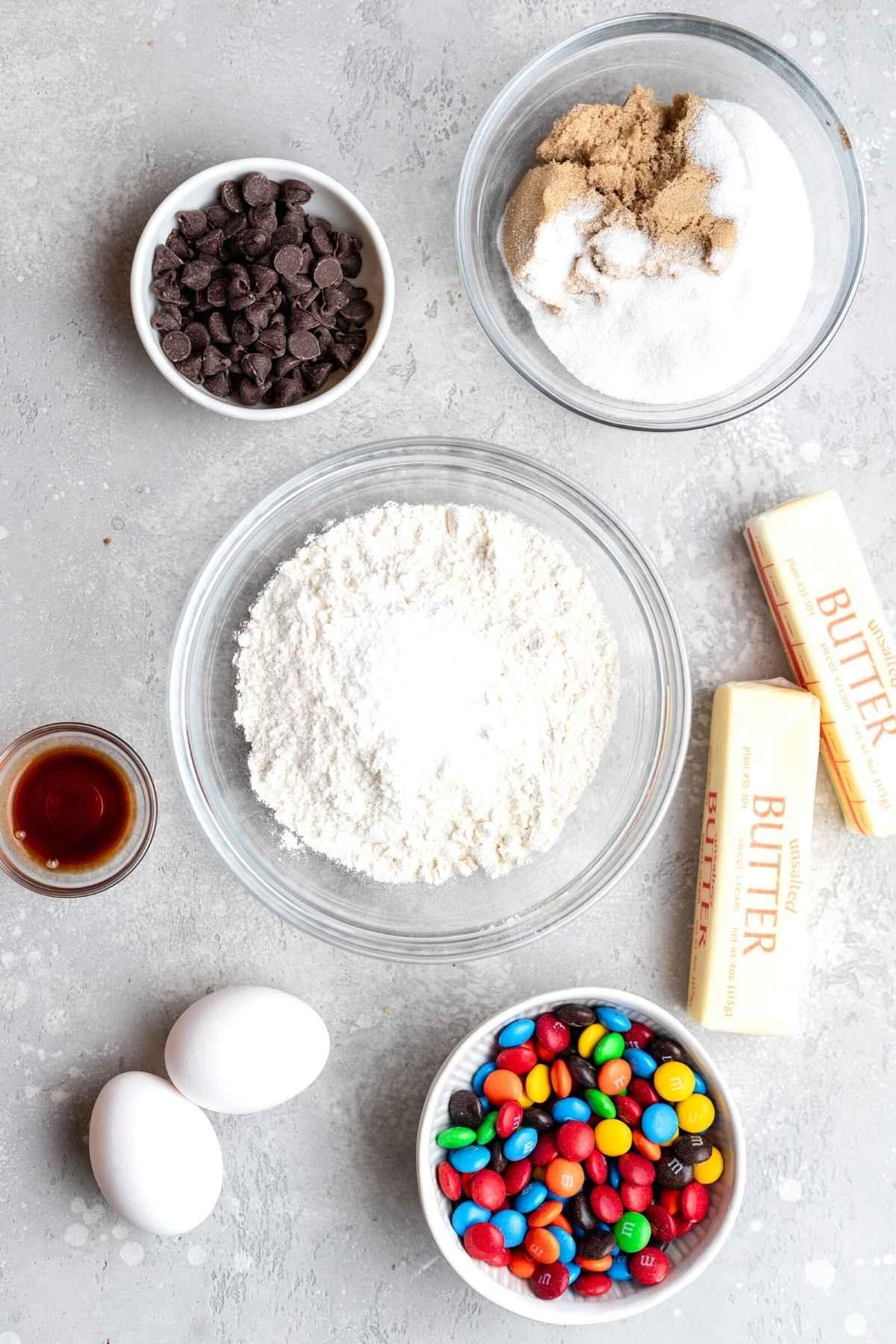 M&M Cookies ingredients in mixing bowls