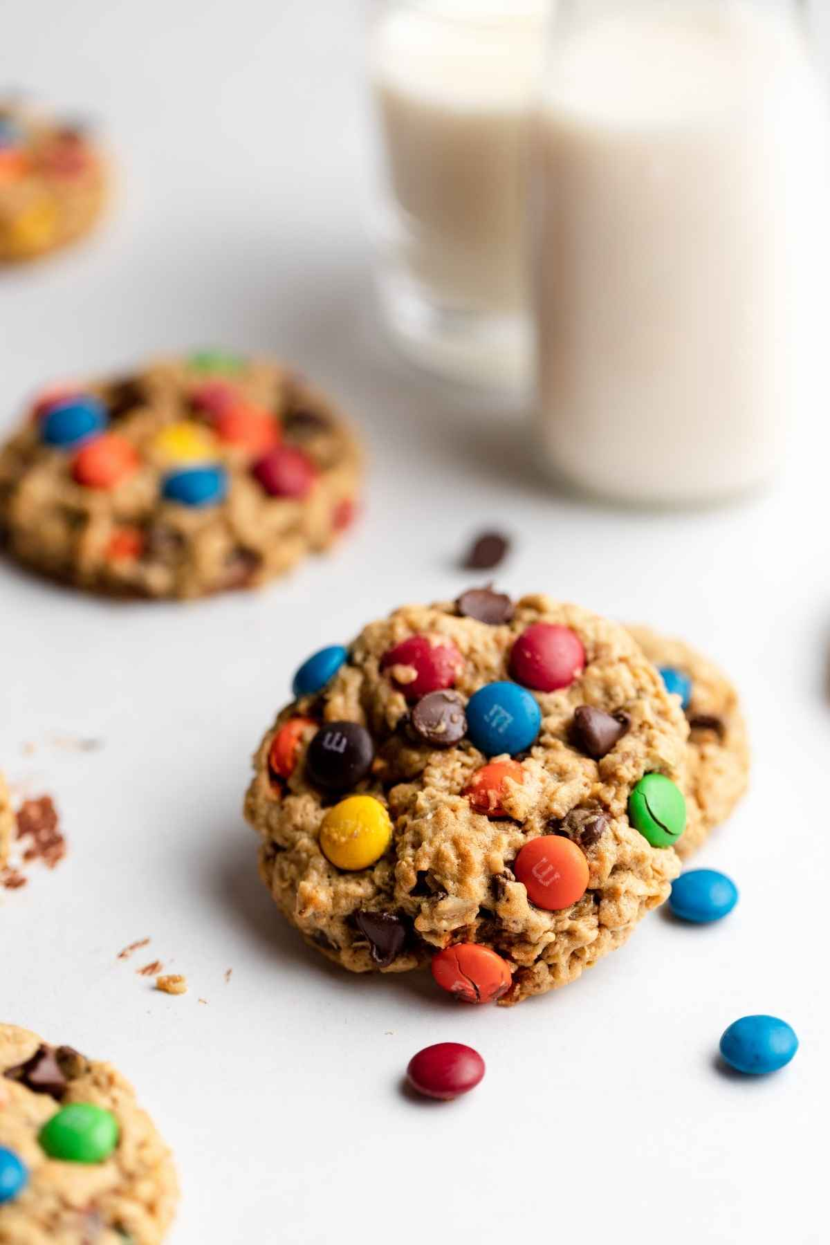 Monster Cookies on table with glass of milk