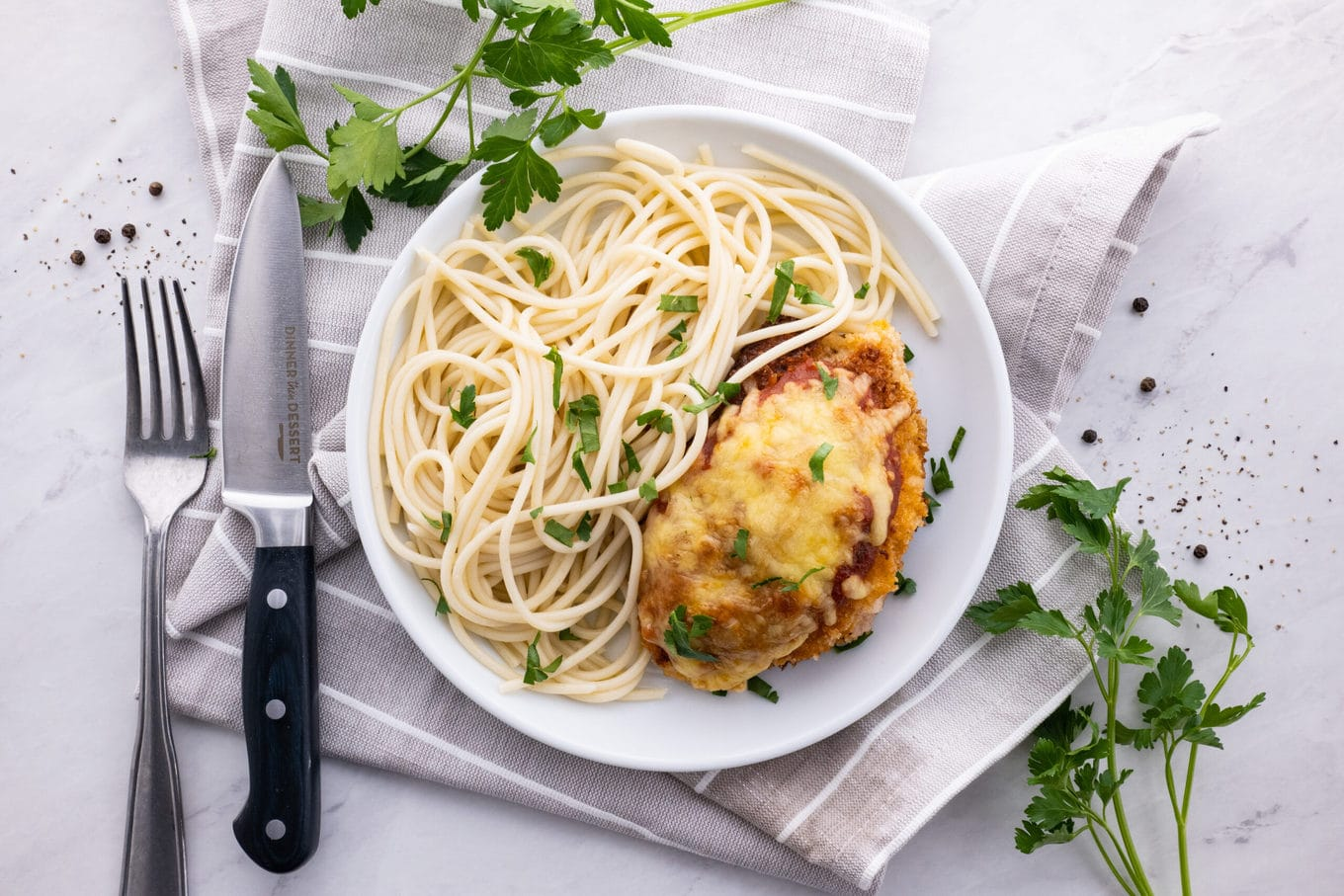 Easy Chicken Parmesan on plate with pasta
